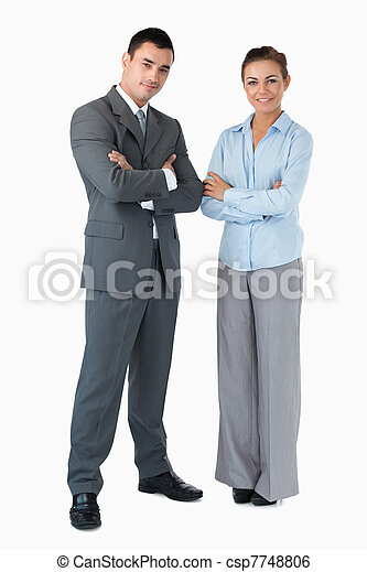 Business partner with arms folded against a white background - csp7748806