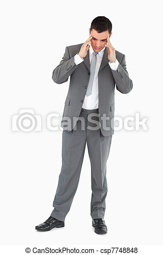 Businessman rubbing his temples - csp7748848