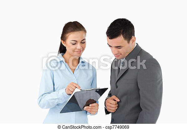 Businesswoman showing data to her partner - csp7749069