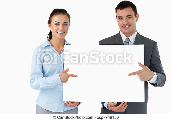 Business partners presenting sign together - csp7749150
