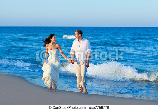 Mediterranean couple walking in blue beach - csp7756779