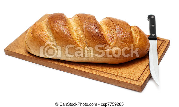 fresh bread with knife on breadboard - csp7759265