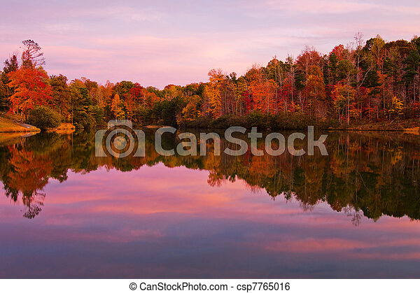 Lake and trees with fall color - csp7765016
