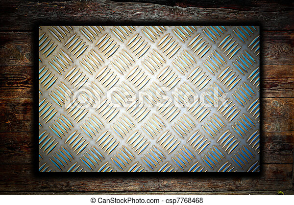 Metal plate on wooden background  - csp7768468