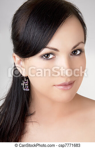 Brunette girl with a beautiful earring. - csp7771683