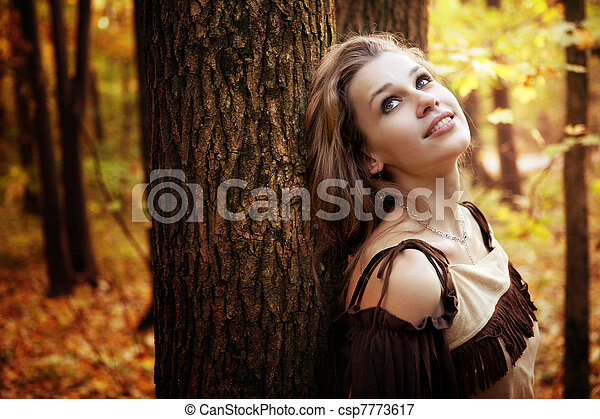 Happy pensive young woman in nature - csp7773617