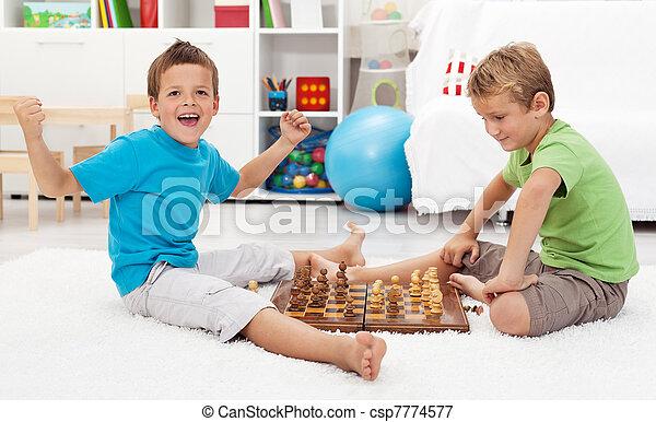 Boy wins chess game - csp7774577
