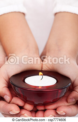 Child and adult hands holding candle - csp7774606