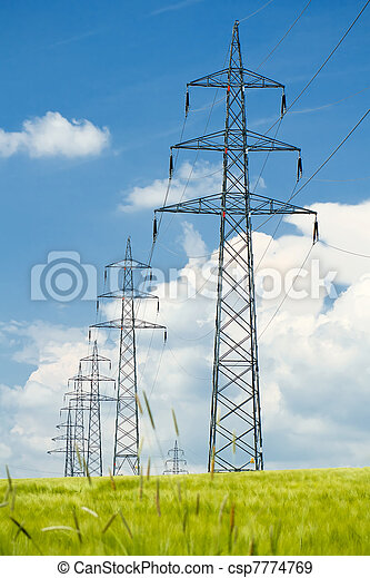 high voltage power lines against a blue sky - csp7774769