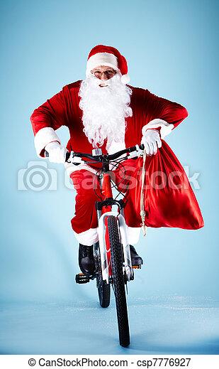 Santa on bicycle - csp7776927