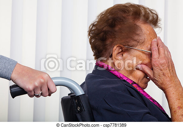 nurse and the old woman in a wheelchair - csp7781389