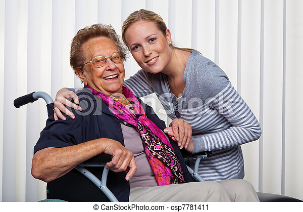 grandchildren visited grandmother in a wheelchair - csp7781411