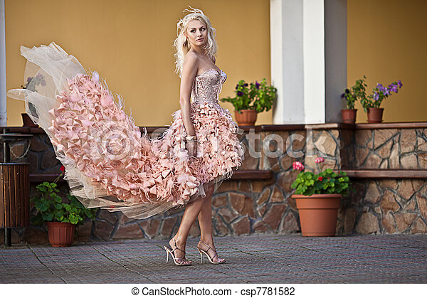 Blond beautiful luxury woman in wedding dress - csp7781582