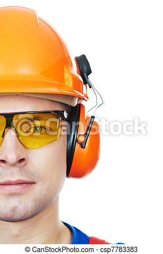 builder in hard hat, earmuffs and goggles - csp7783383