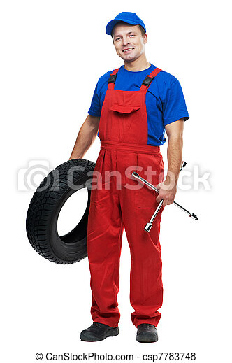 automobile mechanic with car tire and spanner - csp7783748