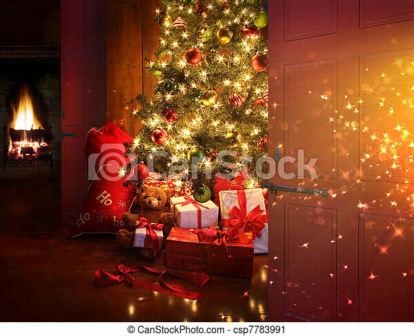 Christmas scene with tree and fire in background - csp7783991