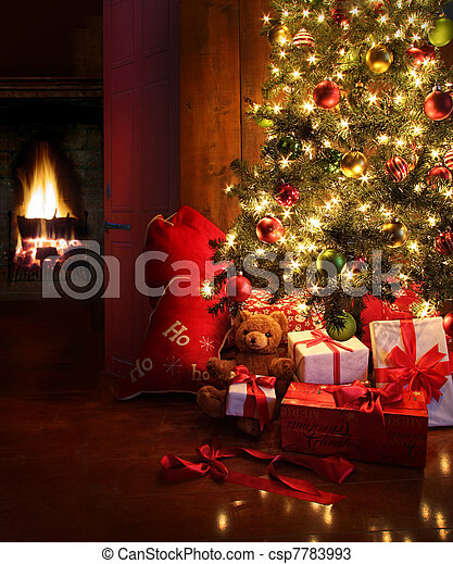 Christmas scene with tree and fire in background - csp7783993