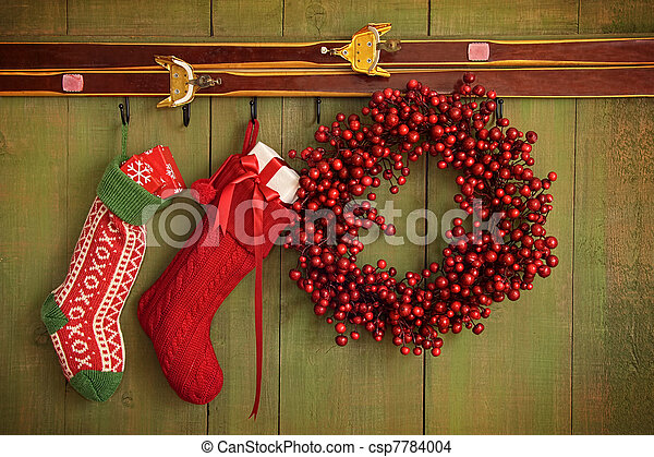 Christmas stockings and wreath hanging on  wall - csp7784004