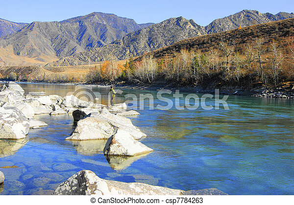 Fishing in clean mountain river by autumn - csp7784263