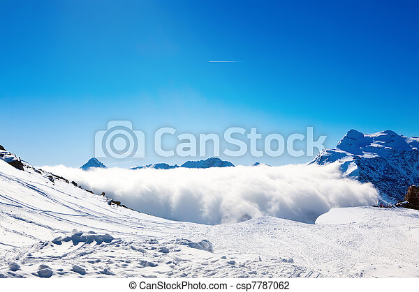 Sun and clouds over mountains - csp7787062