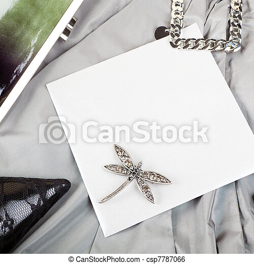 Blank invitation on woman's chic party clothes - csp7787066
