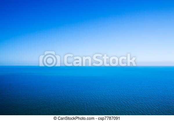 Idyllic abstract background - horizon line between calm sea and clear blue sky - csp7787091