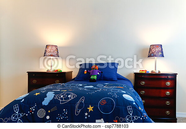 Blue boys bed with two lamps in a white bedroom - csp7788103