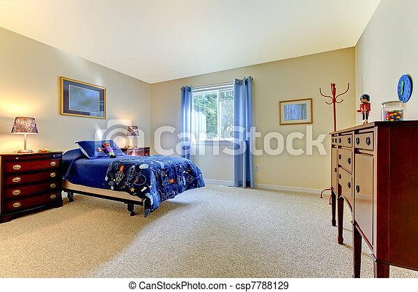 Boys large bedroom with blue bed and beige walls - csp7788129