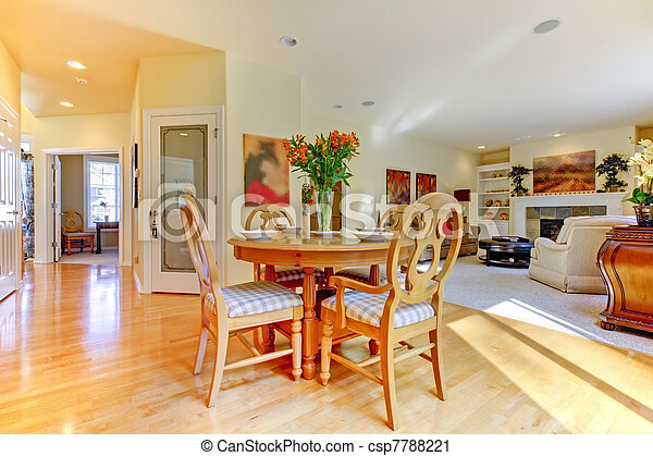 Cozy living room and dining room table and hallway - csp7788221