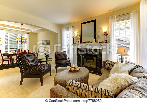 Elegent large golden living room with fireplace  - csp7788250