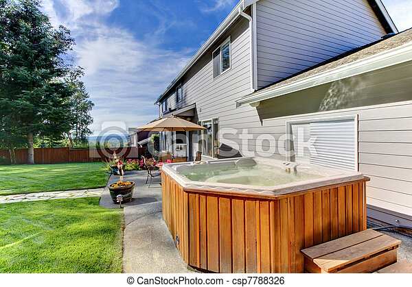 Back yard with house and lrage tub - csp7788326