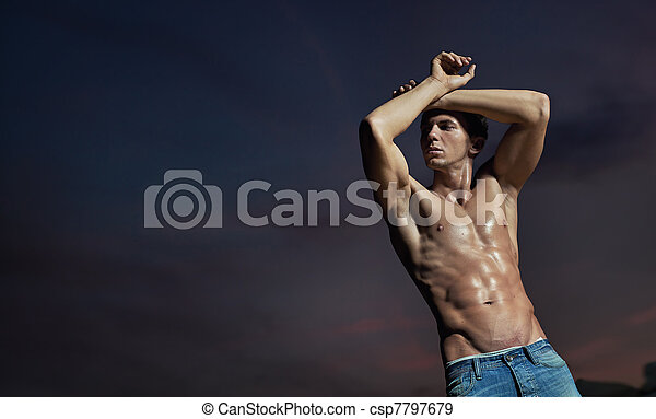 Handsome bodybuilder posing - csp7797679