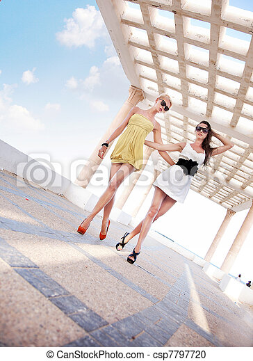 Two adorable women walking in a sunny day - csp7797720