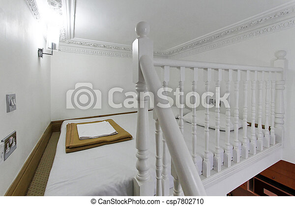Stock fotografie van mezzanine bed kleine studio appartment slaapkamer csp7802710 - Bed kind met mezzanine kantoor ...