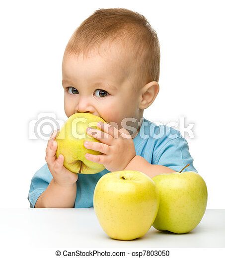 Little boy biting yellow apple - csp7803050