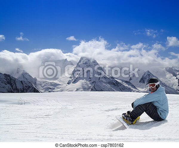 Snowboarder resting on the ski slope - csp7803162