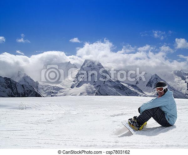Snowboarder resting on the ski slope - csp7803162