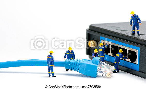 Technicians connecting network cable - csp7808580