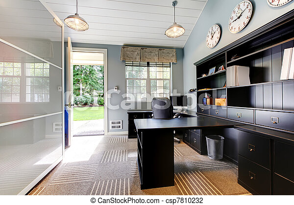 Blue modern home office interior design with dark brown furniture. - csp7810232
