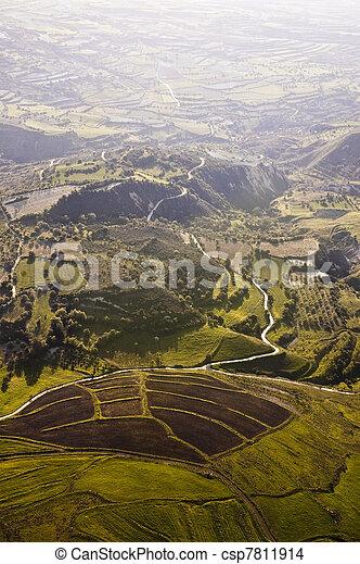 Aerial view of farm fields - csp7811914
