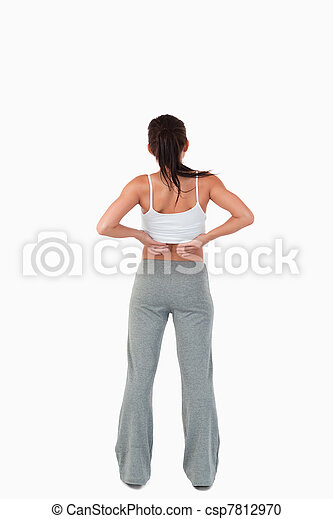 Back view of woman with hands on her hip - csp7812970