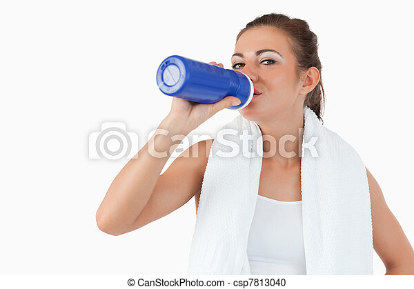 Atletic female taking a sip of water after training - csp7813040