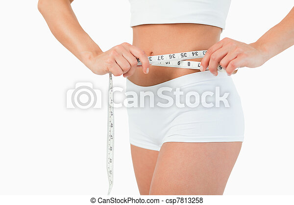 Feminine body with a measuring tape - csp7813258