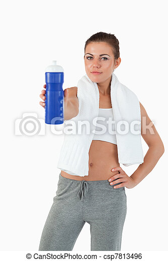 Athletic young woman offering a sip of water - csp7813496