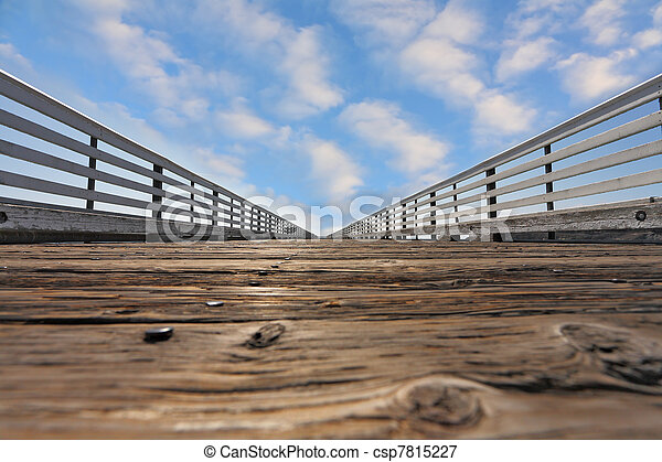 Wooden pier with a handrail on Pacific coast - csp7815227