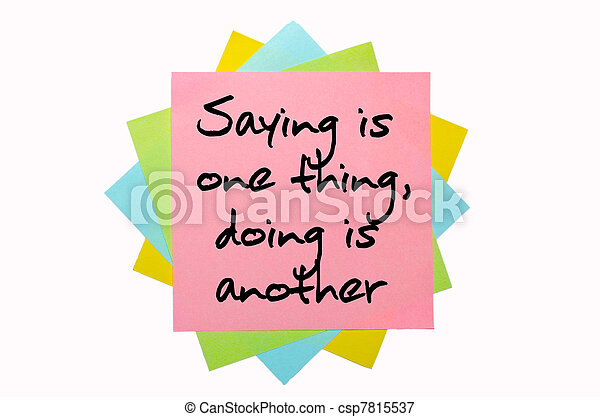 "text "" Saying is one thing, doing is another "" written by hand font on bunch of colored sticky notes - csp7815537"