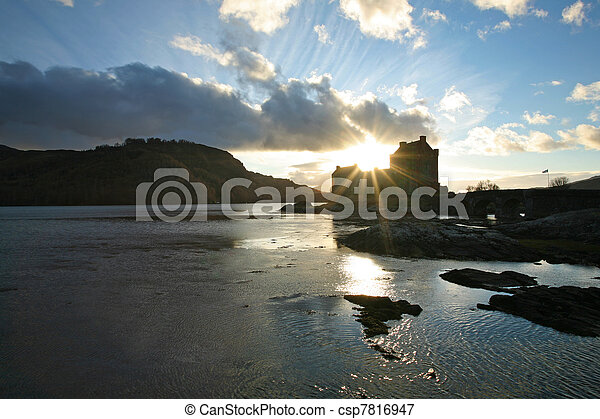 Scotland's iconic Eilean Donan Castle, on the way to Isle of Skye in the Outer Hebrides, seen at sunset - csp7816947