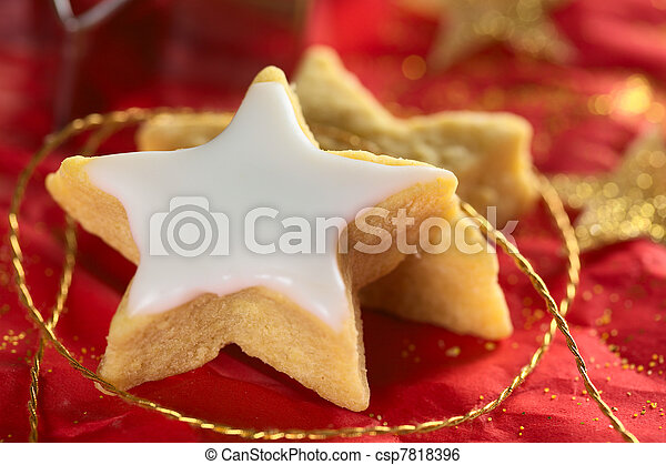 Star shaped cookie with sugar icing  - csp7818396