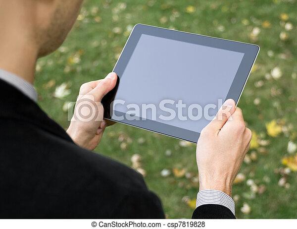 Businessman Holding A Tablet PC - csp7819828