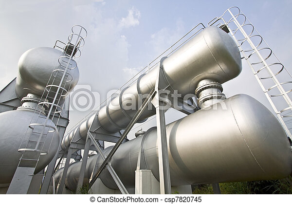 Industrial machines, pipes, tubes, machinery and steam turbine in a power plant.